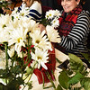 BRYAN EATON/Staff photo. Chris Robicheau, left, and Betty Bonomi, both of West Newbury, work on their flower arrangement at the Newburyport Senior Center during Community Day which brings in a special guest each Wednesday. This week was Pat Cannon, owner of Beach Plum Flower Shop, which gave tips on making the floral centerpieces in time for Valentine's Day for the 40 who attended.