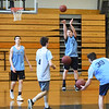 BRYAN EATON/Staff photo. Triton boys basketball team in practice.