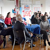 BRYAN EATON/Staff photo. Coastal Connections in Amesbury held a Valentine's Day coffee hour to honor veterans on Thursday morning, here attendees listening to the speakers. Clients of the organization that helps those with disabilities achieve their potential lined up to applaud as veterans entered the building.