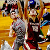 JIM VAIKNORAS/Staff photo Newburyport's Casey McLaren with a layup at Lowell Saturday.