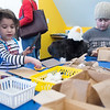 JIM VAIKNORAS/Staff photo Lola Eigen, 4, and her brother Eli, 7, make paper bag owls and eagles nests at the Joppa Flats Education Center during the annual Eagle Festival Saturday.