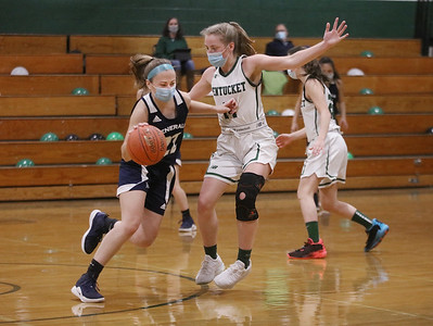 MIKE SPRINGER/Staff photo Sarah Cooke, left, of Hamilton Wenham tries to drive the ball around Greta Maurer of Pentucket during varsity basketball action Tuesday at Pentucket.