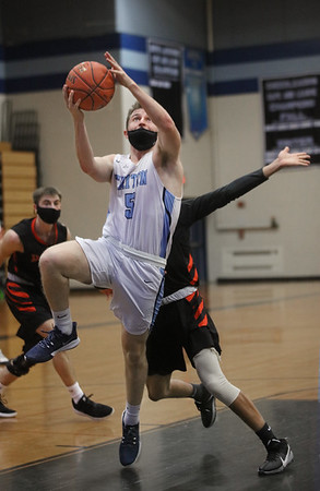 MIKE SPRINGER/Staff photo<br /> Triton's Kyle Odoy goes up for a shot against Ipswich during varsity basketball action Friday at Triton.