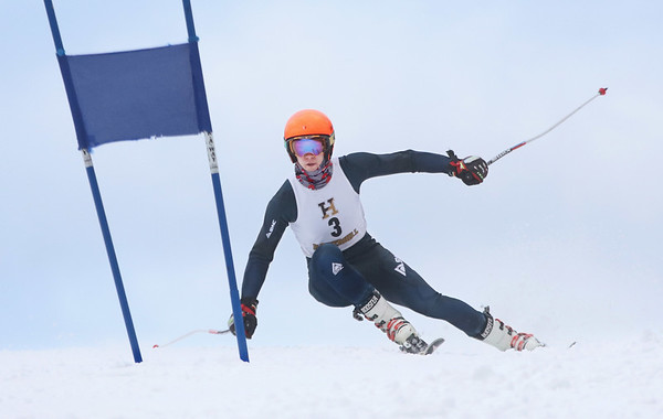 MIKE SPRINGER/Staff photo<br /> Adam Payne of Pentucket Regional High School competes in the giant slalom event as part of the Haverhill High School ski team Friday at the Bradford Ski Area in Haverhill.