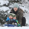 MIKE SPRINGER/Staff photo<br /> Nanny Kiki Emmith prepares to launch brothers Liam, 4, and Bennett Rapp, 2, down the slope Thursday in the fresh snow at March's Hill in Newburyport.