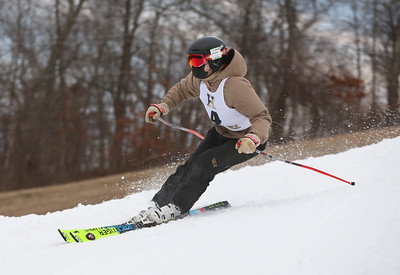 MIKE SPRINGER/Staff photo Charlie Greenberg of Pentucket Regional High School competes in the giant slalom event as part of the Haverhill High School ski team Friday at the Bradford Ski Area in Haverhill.