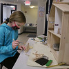 MIKE SPRINGER/Staff photo<br /> Libby Knapp, 11, works on a doll house Thursday at Tinkerhaus in Newburyport. The center was keeping children busy working on crafts between online class sessions.
