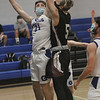 MIKE SPRINGER/Staff photo<br /> Dylan Angelopolus of Georgetown tries to block a shot by Ben Murdock of Rockport during varsity basketball action Tuesday in Georgetown.