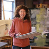 MIKE SPRINGER/Staff photo<br /> Artist Jan Roy of Newburyport at her studio in Haverhill. Roy has donated thousands of her silk screen-printed greeting cards to Pennies for Poverty and Merrimack Valley Habitat for Humanity, to help them raise money.