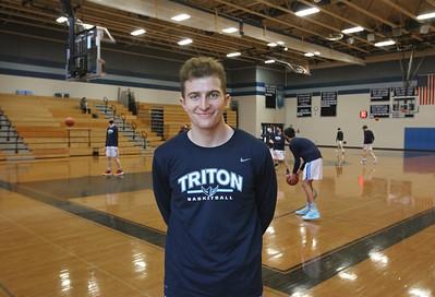 MIKE SPRINGER/Staff photo Kyle Odoy of the Triton varsity basketball team.