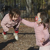 MIKE SPRINGER/Staff photo<br /> Four-year-old Avery Griffin pushes her little sister Layla, 1, on the swing Thursday at Perkins Playground in Newburyport.