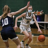 MIKE SPRINGER/Staff photo<br /> Pentucket's Audrey Conover drives toward the basket against Kailee Whelan of Hamilton-Wenham during varsity basketball action Tuesday at Pentucket.