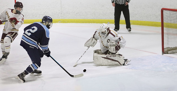 MIKE SPRINGER/Staff photo<br /> Cael Kohan of Triton tries to retake control of the puck after Newburyport goalie Jackson Marshall stopped his shot during varsity hockey action Monday in Newburyport.