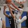 MIKE SPRINGER/Staff photo<br /> Grant Lyon of Georgetown goes up for a basket against Cam Wheeler of Rockport during varsity basketball action Tuesday in Georgetown.
