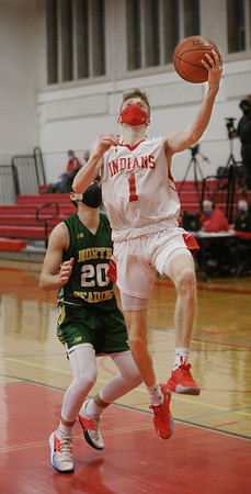 MIKE SPRINGER/Staff photo<br /> Amesbury's Camden Keliher goes up for a lay-up ahead of Andrew Boulas of North Reading during varsity basketball action Friday in Amesbury.