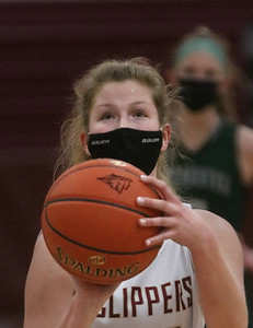MIKE SPRINGER/Staff photo Abigail Gillingham prepares to make a free throw during varsity basketball action Monday against Manchester Essex in Newburyport.