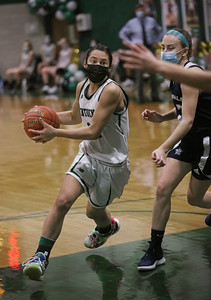 MIKE SPRINGER/Staff photo Pentucket's Gabriella Bellacqua goes in for a layup against Sarah Cooke of Hamilton-Wenham during varsity basketball action Tuesday at Pentucket.