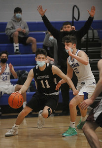 MIKE SPRINGER/Staff photo Kyle Beal of Rockport drives toward the basket against  Cory Walsh of Georgetown during varsity basketball action Tuesday in Georgetown.