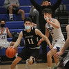 MIKE SPRINGER/Staff photo<br /> Kyle Beal of Rockport drives toward the basket against  Cory Walsh of Georgetown during varsity basketball action Tuesday in Georgetown.