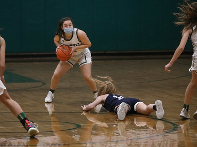 MIKE SPRINGER/Staff photo Pentucket's Bethany Cloutier takes control of the ball as Kailee Whelan of Hamilton-Wenham hits the floor during varsity basketball action Tuesday at Pentucket.