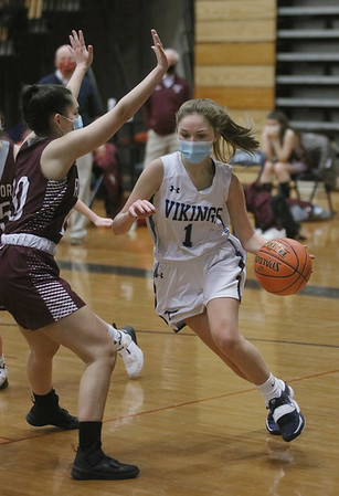 MIKE SPRINGER/Staff photo<br /> Triton's Molly Kimball, right, goes up for a basket against Alexa Osier of Rockport during varsity basketball action Friday at Triton.