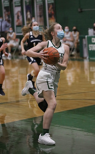 MIKE SPRINGER/Staff photo Pentucket's Greta Maurer moves in for a run-away layup during varsity basketball action Tuesday against Hamilton-Wenham at Pentucket.