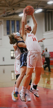 MIKE SPRINGER/Staff photo<br /> Amesbury's Alyssa Pettet pulls a rebound away from Lia Hathaway of Triton during varsity basketball action Wednesday in Amesbury.