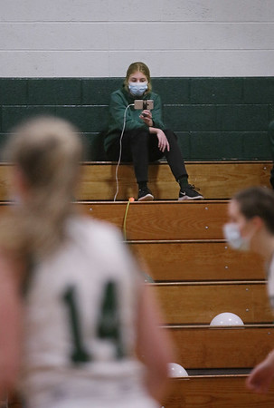 MIKE SPRINGER/Staff photo<br /> Freshman Kaylie Dalgar, a member of the Pentucket girls varsity basketball team, uses a smart phone to live stream Tuesday night's home game against Hamilton-Wenham.