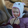 MIKE SPRINGER/Staff photo<br /> Jan Soupcoff of Newburyport tightens the cap of her granddaughter Carys, 3, while playing Thursday at Perkins Playground in Newburyport.