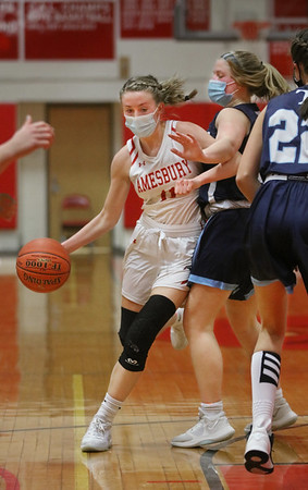 MIKE SPRINGER/Staff photo<br /> Amesbury's Avery Hallinan, left, moves the ball around Caitlin Frary of Triton during varsity basketball action Wednesday in Amesbury.