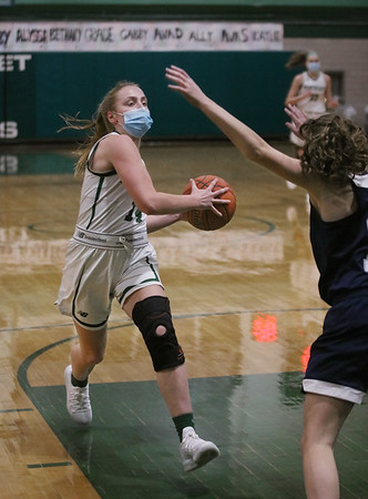 MIKE SPRINGER/Staff photo<br /> Pentucket's Greta Maurer goes up for a basket against Jane Maguire of Hamilton-Wenham during varsity basketball action Tuesday at Pentucket.