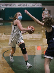 MIKE SPRINGER/Staff photo Pentucket's Greta Maurer goes up for a basket against Jane Maguire of Hamilton-Wenham during varsity basketball action Tuesday at Pentucket.