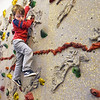 BRYAN EATON/Staff Photo. Lukas Sutton looks for a foothold as moves along the climbing wall in Margaret Welch's physical education class at the Amesbury Elementary School on Wednesday. The five-year-old fell a couple times, but climbed back up to continure the course.