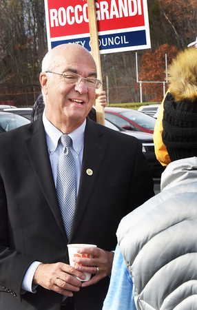 BRYAN EATON/Staff Photo. Amesbury Mayor Ken Gray greets residents as they head in to vote at Amesbury High School.