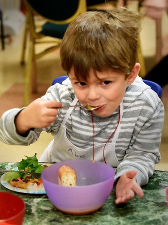 BRYAN EATON/Staff Photo. Abe Epstein, 3, tries the final product which as well as leeks and poatoes, Soares add rutabaga for extra flavor and creaminess without using cream.
