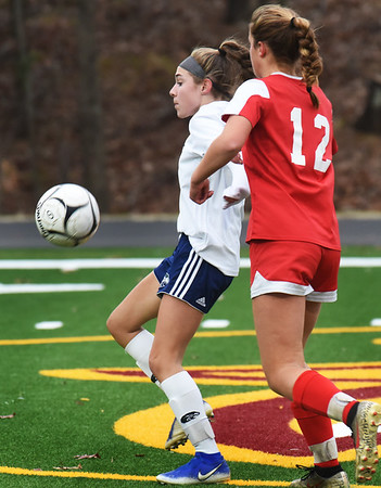 BRYAN EATON/Staff Photo. Essex Tech's Emma Bedard tries to keep the ball from Mary Kate McElaney.