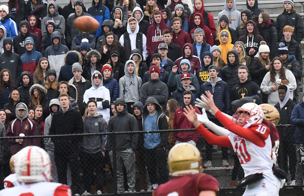 BRYAN EATON/Staff Photo. Amesbury's Drew MacDonald, and Nicholas Petty reach for a pass in the last seconds of the first half.