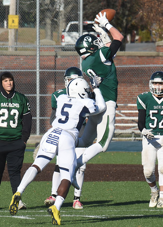 BRYAN EATON/Staff photo. Peter Cleary makes the connection as Swampscott's Zackias Palmer moves in for the tackle.