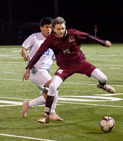 BRYAN EATON/Staff photo. Newburyport's Harry Costello moves for control of the ball over O'Bryant's Robin Avalos.