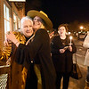 BRYAN EATON/Staff photo. Vaalbara owner Amanda Prescott, with hat, hugs Kathleen Fosher on Saturday night as friends walked to the downtown Newburyport shop holding candles and photos of Vader to give their support to Prescott. Her dog Vader, who was somewhat of a celebrity in the downtown, had to be euthanized as the canine family member had a brain tumor.