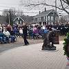 JIM SULLIVAN/Staff photo. The Singing State Trooper, Sgt. Daniel Clark sings for a crowd of roughly 300 during the dedication of Merrimac's new Veterans Memorial Monday.
