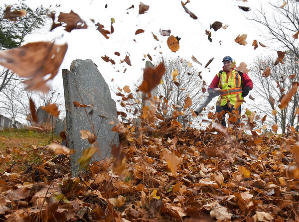 BRYAN EATON/Staff Photo. Kevin Feeley and fellow employees of Newburyport Department of Public Services cleaned the leaves at Old Hill Cemetery after a hiatus due to rain earlier in the week. It won't be too long before they will be getting plows and sanders ready as winter is not far away.