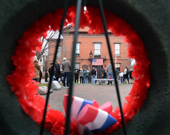 BRYAN EATON/Staff Photo. People listen as Newburyport Mayor Donna Holaday reads off the names of veterans residing in Newburyport who have died since Memorial Day as a bell is rung for each person.