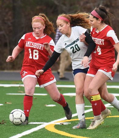 BRYAN EATON/Staff Photo. Essex Tech's Hope Miller gets squeezed by Gracie Doherty (18) and Ashlee Porcaro.