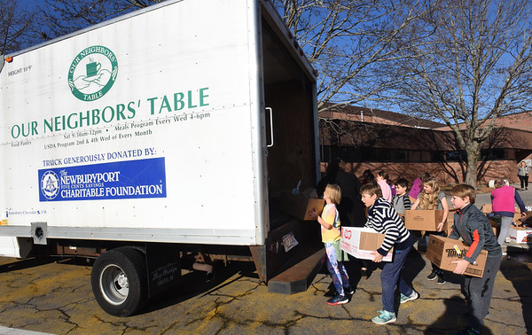 BRYAN EATON/Staff Photo. The Cashman School's fourth grade student council organized once again a Thanksgiving Food Drive which started just after Halloween. Monday was the day the Our Neighbors' Table sent the truck to be filled with the non-perishable items.