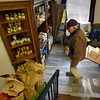 BRYAN EATON/Staff Photo. Volunteers from Stone Ridge Properties helped out other volunteers from the Newbury Community Food Pantry to unload several trucks of food at the First Parish of Newbury for distribution this afternoon in time for Thanksgiving. In addition to canned goods, carrots, potatoes, paper products and more, they also unloaded 73 frozen turkeys for those in need.