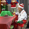BRYAN EATON/Staff photo. Sebastian the Elf, a.k.a. Bob Walker, takes a lunch break of taco salad while working Santa's Workshop booth at the Holy Family Parish Hall.