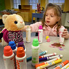 "BRYAN EATON/Staff Photo. Julia Barrella uses different colored ink blotters as she paints her interpretation of ""kitty cat"" at the Newburyport Rec Center on Tuesday afternoon. The two year-old was at the Stuffed Animal-themed Afternoon Tea Party where they also were read stories and enjoyed snacks at the event co-hosted by Newburyport Youth Services and Family Connections."