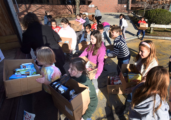 BRYAN EATON/Staff Photo. The Cashman School's fourth grade student council organized once again a Thanksgiving Food Drive which started just after Halloween. Monday was the day the Our Neighbors' Table sent the truck to be filled with the non-perishable items which they're loading up here.