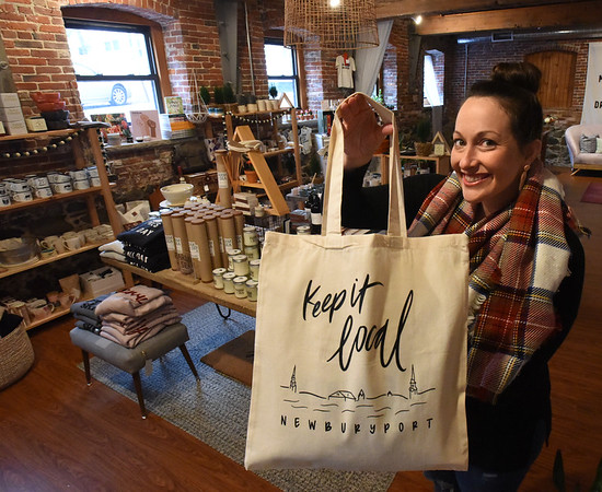 BRYAN EATON/Staff Photo. Salt and Grove co-owner Sarah Landry with this year's Keep It Local bag for shoppers this Saturday in Newburyport.
